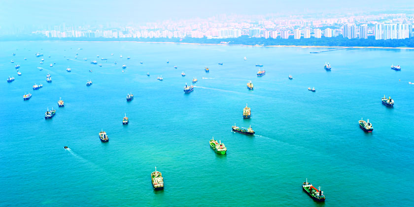 freight ships wait in singapore waters